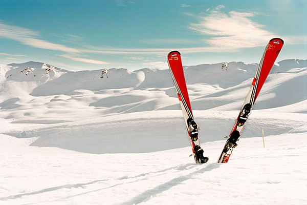 Skis standing upright in snow